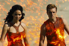 Katniss and Peeta at Tribute Parade